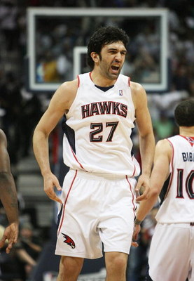 ATLANTA - MAY 03:  Zaza Pachulia #27 of the Atlanta Hawks celebrates after assisting on a basket in the second quarter while taking on the Miami Heat during Game Seven of the Eastern Conference Quarterfinals at Philips Arena on May 3, 2009 in Atlanta, Geo