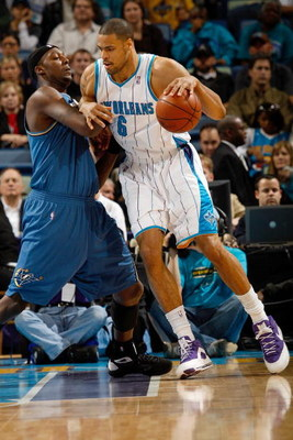 NEW ORLEANS - DECEMBER 30:  Tyson Chandler #6 of the New Orleans Hornets drives the ball around Andray Blatche #32 of the Washington Wizards on December 30, 2008 at the New Orleans Arena in New Orleans, Louisiana.  NOTE TO USER: User expressly acknowledge