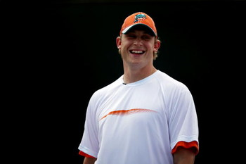 KEY BISCAYNE, FL - MARCH 25:  Quarterback Chad Pennington of the Miami Dolphins plays a friendly match against Nadia Petrova during day three of the Sony Ericsson Open at The Crandon Park Tennis Center on March 25, 2009 in Key Biscayne, Florida.  (Photo b