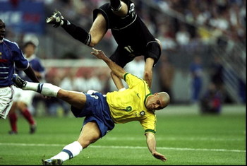 12 Jul 1998:  France goalkeeper Fabien Barthez collides with Ronaldo of Brazil during the World Cup Final at the Stade de France in St Denis. France won 3-0. \ Mandatory Credit: Ben Radford /Allsport