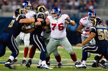 ST. LOUIS, MO - SEPTEMBER 14:  Chris Snee #76 of the New York Giants blocks the line during the game against the St. Louis Rams at Edward Jones Dome on September 14, 2008 in St. Louis, Missouri. (Photo by Dilip Vishwanat/Getty Images)