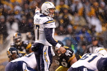 PITTSBURGH - JANUARY 11:  Snow falls as Philip Rivers #17 of the San Diego Chargers gestures at the line of scrimmage against the Pittsburgh Steelers during their AFC Divisional Playoff Game on January 11, 2009 at Heinz Field in Pittsburgh, Pennsylvania.