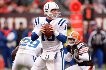 CLEVELAND - NOVEMBER 30:  Quarterback Peyton Manning #18 of the Indianapolis Colts looks to make a pass play during their NFL game against the Cleveland Browns on November 30, 2008 at Cleveland Browns Stadium in Cleveland, Ohio. The Colts defeated the Bro