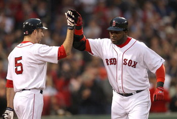 BOSTON - JUNE 11:  David Ortiz #34 of the Boston Red Sox hits a home run and celebrates with teammate Rocco Baldelli against the New York Yankees at Fenway Park on June 11, 2009 in Boston, Massachusetts.  (Photo by Jim Rogash/Getty Images)