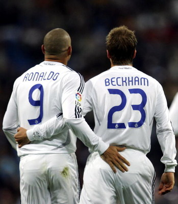 MADRID, SPAIN - NOVEMBER 09:  David Beckham of Real Madrid celebrates with Ronaldo after scoring a goal against Ecija during the Kings Cup fourth round second leg match between Real Madrid and Ecija at the Santiago Bernabeu stadium on November 9, 2006 in