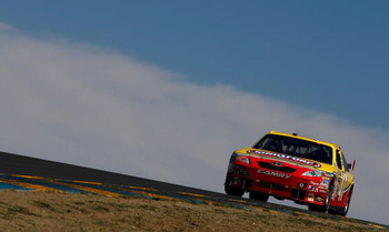 SONOMA, CA - JUNE 19: Marcos Ambrose, driver of the #47 Little Debbie/Kingsford/Clorox Toyota, drives during qualifying for the NASCAR Sprint Cup Series Toyota/Save Mart 350 at the Infineon Raceway on June 19, 2009 in Sonoma, California.  (Photo by Jonath