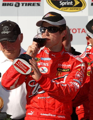 SONOMA, CA - JUNE 21: Kasey Kahne, driver of the #9 Budweiser Dodge, celebrates in victory lane after winning the NASCAR Sprint Cup Series Toyota/Save Mart 350 at the Infineon Raceway on June 21, 2009 in Sonoma, California.  (Photo by Ezra Shaw/Getty Imag