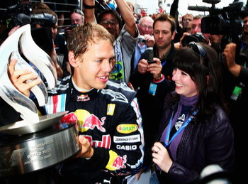 NORTHAMPTON, UNITED KINGDOM - JUNE 21:  Sebastian Vettel of Germany and Red Bull Racing celebrates with team mates in the paddock after winning the British Formula One Grand Prix at Silverstone on June 21, 2009 in Northampton, England.  (Photo by Clive Ma