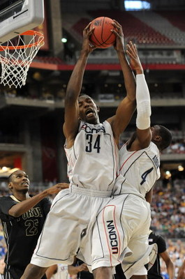 GLENDALE, AZ - MARCH 26:  Center Hasheem Thabeet #34 of the Connenticut Huskies grabs a rebound against the Purdue Boilermakers in the Sweet 16 of the NCAA Division I Men's Basketball Tournament at the University of Phoenix Stadium on March 26, 2009 in Gl