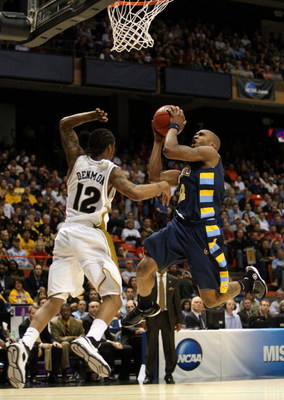 BOISE, ID - MARCH 22:  Guard Jerel McNeal #22 of the Marquette Golden Eagles drives the ball to the hoop against the Missouri Tigers during the second round of the NCAA Division I Men's Basketball Tournament at the Taco Bell Arena on March 22, 2009 in Boi