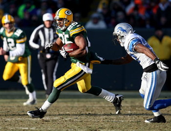 GREEN BAY, WI - DECEMBER 28: Ryan Grant #25 of the Green Bay Packers runs past Daniel Bullocks #27 of the Detroit Lions on December 28, 2008 at Lambeau Field in Green Bay, Wisconsin. The Packers defeated the Lions 31-21. (Photo by Jonathan Daniel/Getty Im
