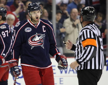COLUMBUS, OHIO - APRIL 23:  Rick Nash #61 of the Columbus Blue Jackets questions referee Dan O'Halloran #13 about a late game call against the Detroit Red Wings during Game Four of the Western Conference Quarterfinals of the 2009 Stanley Cup Playoffs on A