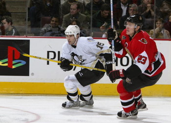 OTTAWA - JANUARY 22:  Center Brian Holzinger #15 of the Pittsburgh Penguins skates past defenseman Karel Rachunek #23 of the Ottawa Senators during the game at Corel Centre on January 22, 2004 in Ottawa, Ontario. The Senators defeated the Penguins 6-5. (P