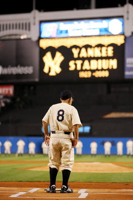 NEW YORK - SEPTEMBER 21:  Yogi Berra stands on the field during a pregame ceremony prior to the start of the last regular season game at Yankee Stadium between the Baltimore Orioles and the New York Yankees on September 21, 2008 in the Bronx borough of Ne
