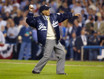 BRONX, NY - OCTOBER 9:  Yankee great Phil Rizzuto throws out the game's first pitch to former teammate Yogi Berra during game 2 of the American League Championship Series between the New York Yankees and Boston Red Sox on October 9, 2003 at Yankee Stadium