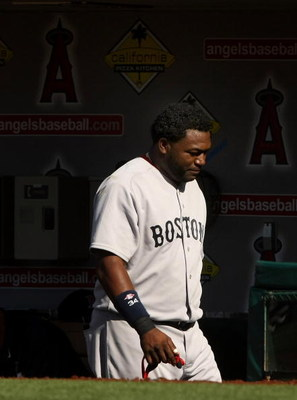 ANAHEIM, CA - MAY 14:  David Ortiz #34 of the Boston Red Sox walks in the dugout after grounding out for the final out with the bases loaded in the 12th inning against  the Los Angeles Angels of Anaheim on May 14, 2009 at Angel Stadium in Anaheim, Califor