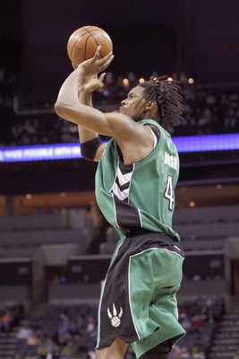 CHARLOTTE, NC - MARCH 16:  Chris Bosh #4 of the Toronto Raptors makes a jumpshot against the Charlotte Bobcats during their game at Time Warner Cable Arena on March 16, 2009 in Charlotte, North Carolina.  NOTE TO USER: User expressly acknowledges and agre