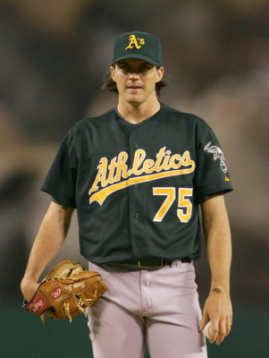 ANAHEIM, CA - AUGUST 30:  Barry Zito #75 of the Oakland Athletics looks on during the game against the Los Angeles Angels of Anaheim on August 30, 2005 at Angel Stadium in Anaheim, California.  The Athletics won 2-1.  (Photo by Lisa Blumenfeld/Getty Image