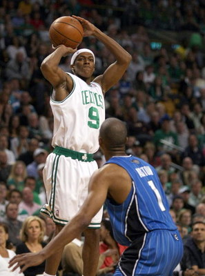 BOSTON - MAY 17:  Rajon Rondo #9 of the Boston Celtics takes a shot as Rafer Alston #9 of the Orlando Magic defends in Game Seven of the Eastern Conference Semifinals during the 2009 NBA Playoffs at TD Banknorth Garden on May 17, 2009 in Boston, Massachus