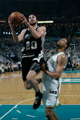 NEW ORLEANS - MAY 19:  Manu Ginobili #20 of the San Antonio Spurs makes a shot over Tyson Chandler #16 of the New Orleans Hornets in Game Seven of the Western Conference Semifinals during the 2008 NBA Playoffs at The New Orleans Arena on May 19, 2008 in N