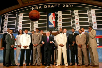 NEW YORK - JUNE 28: NBA Commissioner David Stern (C) throws a basketball at the media while posing with (L-R) Al Horford, Acie Law IV, Joakim Noah, Nick Young, Kevin Durant, Corey Brewer, Yi Jianlian, Greg den, Julian Wright, Rodney Stuckey, Spencer Hawes