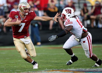 ORLANDO, FL - DECEMBER 27:  Christian Ponder #7 of the Florida State Seminoles attempts to avoid the tackle of Culmer St. Jean #15 of the Wisconsin Badgers during the Champs Bowl on December 27, 2008 at the Citrus Bowl in Orlando, Florida.  (Photo by Sam