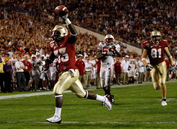 ORLANDO, FL - DECEMBER 27:  Carlton Jones #33 of the Florida State Seminoles scores a touchdown during the Champs Bowl against the Wisconsin Badgers on December 27, 2008 at the Citrus Bowl in Orlando, Florida.  (Photo by Sam Greenwood/Getty Images)