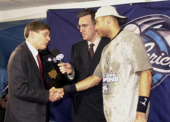 26 Oct 2000:  Derek Jeter of the New York Yankees is awarded the MVP trophy by commissioner Bud Selig after the Yankees defeated the New York Mets 4-2 during Game 5 of the World Series at Shea Stadium in Flushing, New York. <DIGITAL IMAGE> Mandatory Credi