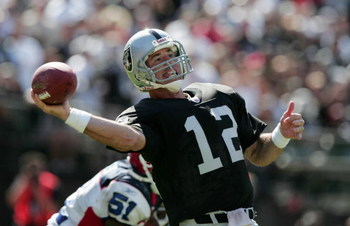 OAKLAND, CA - SEPTEMBER 19:  Quaterback Rich Gannon #12 of the Oakland Raiders passes the ball against the Buffalo Bills during the game at Network Associates Coliseum on September 19, 2004 in Oakland, California. The Raiders defeated the Bills 13-10. (Ph