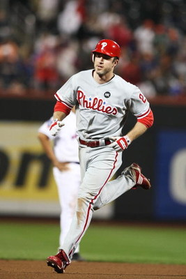 NEW YORK - JUNE 10:  Chase Utley #26 of the Philadelphia Phillies rounds the bases after hitting a home run against The New York Mets in the eleventh inning putting the Phillies ahead 5-4 during their game on June 10, 2009 at Citi Field in the Flushing ne