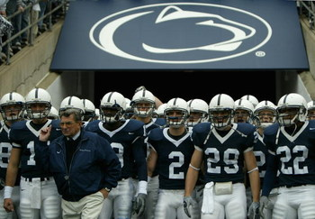 STATE COLLEGE, PA - OCTOBER 23:  Head coach Joe Paterno of the Penn State Nittnay Lions leads his team onto the field as the Iowa Hawkeyes defeated Penn State Nittnay Lions 6-4 during NCAA football at Beaver Stadium on October 23, 2004 in State College, P