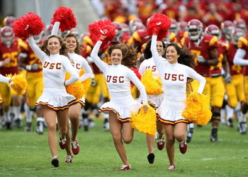 LOS ANGELES - SEPTEMBER 22:  Cheerleaders run onto the field ahead of the USC Trojans before the game with the Washington State Cougars on September 22, 2007 at the Los Angeles Coliseum in Los Angeles, California.  USC won 47-14. (Photo by Stephen Dunn/Ge