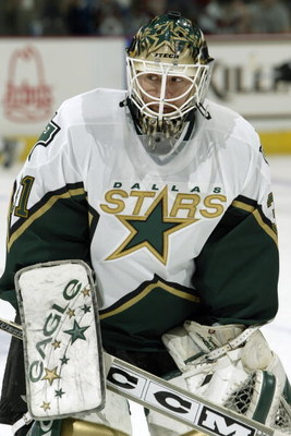 DENVER - APRIL 17:  Goaltender Ron Tugnutt #31 of the Dallas Stars warms up for game five of the Stanley Cup playoffs against the Colorado Avalanche at the Pepsi Center on April 17, 2004 in Denver, Colorado.  The Avalanche won 5-1.  (Photo by Brian Bahr/G