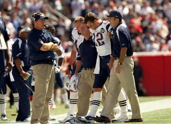 FOXBORO, MA - SEPTEMBER 7:  Quarterback Tom Brady #12 of the New England Patriots walks off the field with the aid of the Patriots staff after being injured on a play during their NFL game against the Kansas City Chiefs on September 7, 2008 at Gillette St