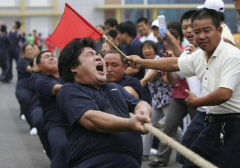 BEIJING - JULY 08:  Chinese people in a Tug-of-War match at the Farmers Game, part of the 4th 'Beijing 2008' Olympic Cultural Festival on July 8, 2006 in Beijing, China. (Photo by Cancan Chu/Getty Images)