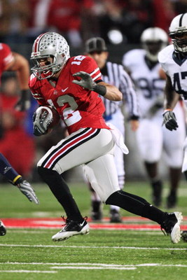 COLUMBUS, OH - OCTOBER 25: Wide receiver Dane Sanzenbacher #12 of the Ohio State Buckeyes runs with the ball against the Penn State Nittany Lions on October 25, 2008 at Ohio Stadium in Columbus, Ohio.  (Photo by Jamie Sabau/Getty Images)