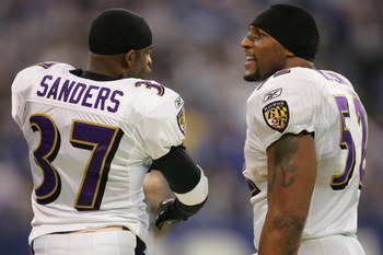 INDIANAPOLIS, IN - DECEMBER 19:  Cornerback Deion Sanders #37 and linebacker Ray Lewis #52 of the Baltimore Ravens talk during the game against the Indianapolis Colts on December 19, 2004 at the RCA Dome in Indianapolis, Indiana. The Colts defeated the Ra