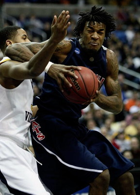 WASHINGTON - MARCH 20:  Jordan Hill #45 of the Arizona Wildcats goes to the hoop against Wellington Smith #35 of the West Virginia Mountaineers during the first round of the West Regional as part of the 2008 NCAA Men's Basketball Tournament at the Verizon