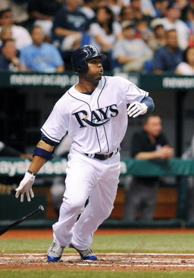 ST. PETERSBURG, FL - APRIL 15: Outfielder Carl Crawford #13 of the Tampa Bay Rays bats against the New York Yankees at Tropicana Field on April 15, 2009 in St. Petersburg, Florida.  (Photo by Al Messerschmidt/Getty Images)