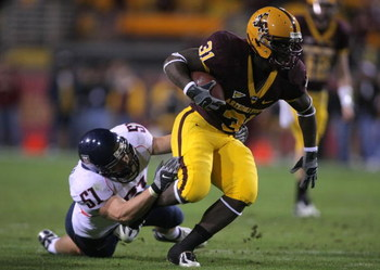 TEMPE, AZ - DECEMBER 01:  Dimitri Nance #31 of the Arizona State breaks the tackle of Spencer Larsen #51 of the University of Arizona Wildcats during the second quarter at Sun Devil Stadium on December 1, 2007 in Tempe, Arizona.  (Photo by Harry How/Getty