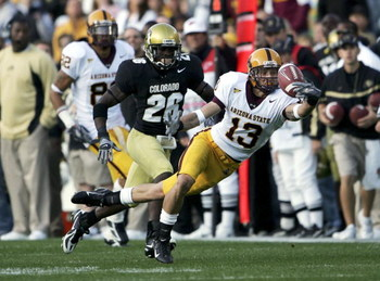 BOULDER, CO - SEPTEMBER 16:  Chris McGaha #13 of the Arizona State Sun Devils is unable to hang onto a pass as Terrence Wheatley #26 of the University of Colorado Buffaloes defends at Folsom Field on September 16, 2006 in Boulder, Colorado.  (Photo by Dou