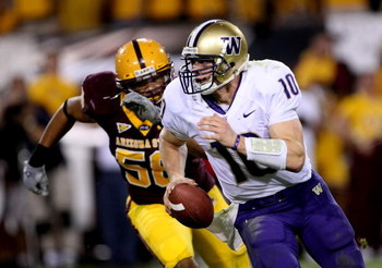 TEMPE, AZ - OCTOBER 13:  Quarterback Jake Locker #10 of the Washington Huskies runs away from the pursuit of linebacker Dexter Davis #58 of the Arizona State Sun Devils on October 13, 2007 at Sun Devil Stadium in Tempe, Arizona.  Arizona State won 44-20.