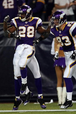 MINNEAPOLIS - JANUARY 4:  Adrian Peterson #28 of the Minnesota Vikings celebrates his touchdown with teammate Jeff Dugan #83 in the first half against the Philadelphia Eagles during the NFC Wild Card playoff game on January 4, 2009 at the Hubert H. Humphr