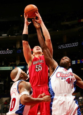 LOS ANGELES - NOVEMBER 23:  Rafael Araujo #55 of the Toronto Raptors jumps for a rebound as Elton Brand #42 and Corey Maggette #50 try to grab the ball as the Clippers go on to win 103-100 on November 23, 2005 at Staples Center in Los Angeles, California.