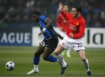 MILAN, ITALY - FEBRUARY 24:  Sulley Muntari of Inter Milan gets past John O'Shea of Manchester United during the UEFA Champions League, Round of Last 16, First Leg match between Inter Milan and Manchester United at the San Siro Stadium on February 24, 200