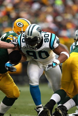 GREEN BAY, WI - NOVEMBER 30:  Julius Peppers #90 of the Carolina Panthers rushes the passer against the Green Bay Packers at Lambeau Field on November 30, 2008 in Green Bay, Wisconsin. The Panthers won 35-31.  (Photo by Jonathan Daniel/Getty Images)