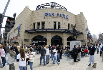 PITTSBURGH - APRIL 13:  Fans enter the ballpark and receive free caps on opening day for the Pittsburgh Pirates prior to playing the Houston Astros at PNC Park April 13, 2009 in Pittsburgh, Pennsylvania.  (Photo by Gregory Shamus/Getty Images)