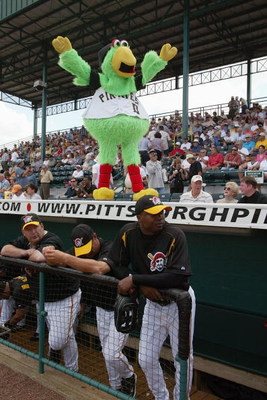 BRADENTON, FL - MARCH 4:  Pirate Parot, the mascot of the Pittsburgh Pirates, gets the crowd going during their game against the Cinncinati Reds during Spring Training March 4, 2004 at McKechnie Field  in Bradenton, Florida. (Photo by Eliot J. Schechter/G