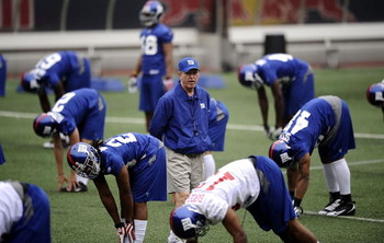 EAST RUTHERFORD, NJ - MAY 09: Tom Coughlin, head coach of the New York Giants walks on the field at rookie camp on May 9, 2009 in East Rutherford, New Jersey.  (Photo by Jeff Zelevansky/Getty Images)
