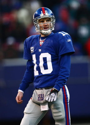 EAST RUTHERFORD, NJ -  JANUARY 11:  Eli Manning #10 of the New York Giants looks on against the Philadelphia Eagles during the NFC Divisional Playoff Game on January 11, 2009 at Giants Stadium in East Rutherford, New Jersey.  The Eagles defeated the Giant